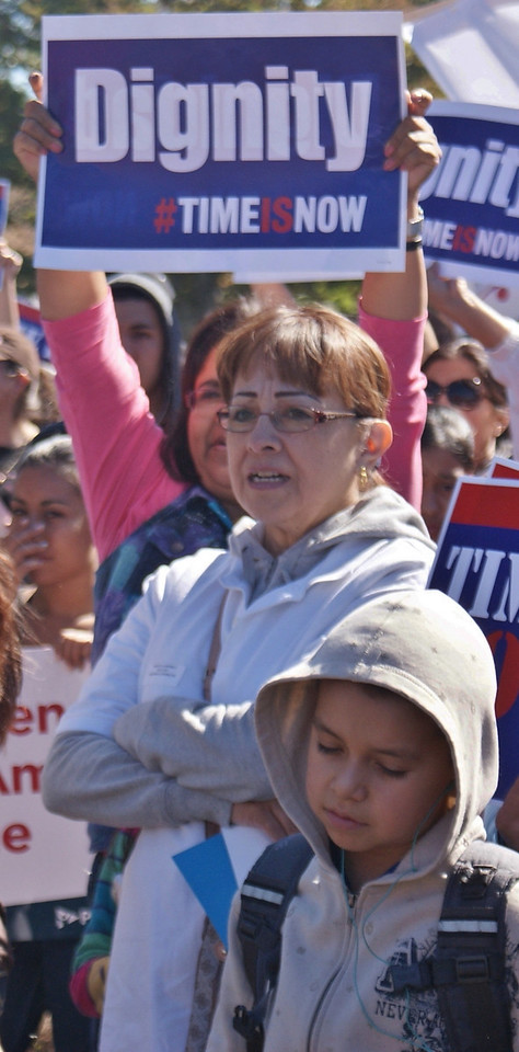 Latina woman and young boy at immigration reform rally.