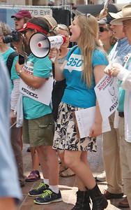 Young woman with megeaphone speaks at anti KXL pipeline demonstration in Washington. DC.
