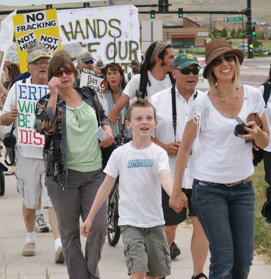 Woamn and young son at an anti-fracking march in Erie, co.