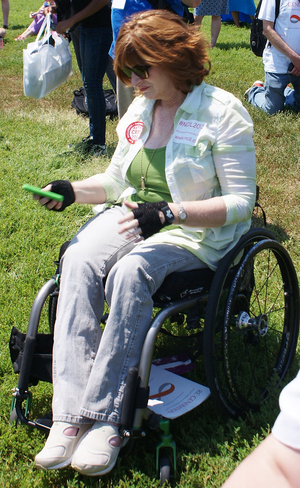 Woman in wheelchair at rally for rights of disabled people in Washington, DC.