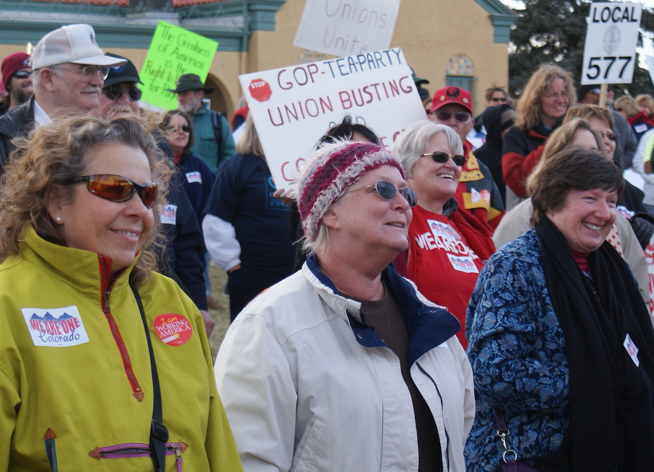 """Union women at a """"We Are One"""" union rally in Denver."""