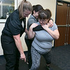 The Vanessa T. Marcotte foundation in association with The Worcester County Sheriff's Office held a women's self protection program at Fidelity Bank in Leominster on Thursday night, Nov. 7, 2019. During the program they learned some common types of attacks and how to get way from them. One of the types of attacks they learned to get away from was a choke hold from behind.  Instructor Moira Poole helps Shannon Smith, behind, and Denise Belliveau as they learn to get out of this hold. SENTINEL & ENTERPRISE/JOHN LOVE