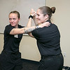 The Vanessa T. Marcotte foundation in association with The Worcester County Sheriff's Office held a women's self protection program at Fidelity Bank in Leominster on Thursday night, Nov. 7, 2019. During the program they learned some common types of attacks and how to get way from them. One of the types of attacks they learned to get away from was a choke hold.  Showing the class how to get out of it is Instructors Maeve McLaughlin, right, and Courtney Powers. SENTINEL & ENTERPRISE/JOHN LOVE