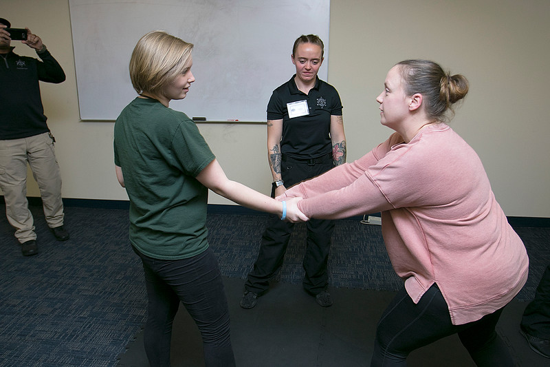 The Vanessa T. Marcotte foundation in association with The Worcester County Sheriff's Office held a women's self protection program at Fidelity Bank in Leominster on Thursday night, Nov. 7, 2019. During the program they learned some common types of attacks and how to get way from them. The first type of attack they learned about was the arm grab. Here Instructor Courtney Powers watches as Jamie Goodall, in green, and Megan White practice getting out of this hold. SENTINEL & ENTERPRISE/JOHN LOVE