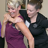 The Vanessa T. Marcotte foundation in association with The Worcester County Sheriff's Office held a women's self protection program at Fidelity Bank in Leominster on Thursday night, Nov. 7, 2019. During the program they learned some common types of attacks and how to get way from them. One of the types of attacks they learned to get away from was a choke hold from behind. Instructor Meghan Smith helps Patty McCarty Guillette, in purple, with her technique in getting out of this hold. SENTINEL & ENTERPRISE/JOHN LOVE
