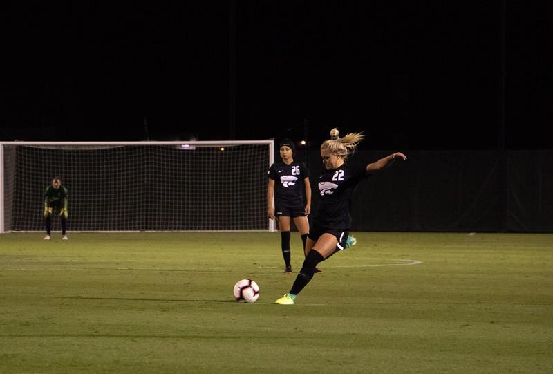 Sophmore forward Hannah Davis kicks the ball in a pass towards the Oklahoma goal. In total Davis had 8 shots on goal. (Rowan Jones|Collegian Media Group)
