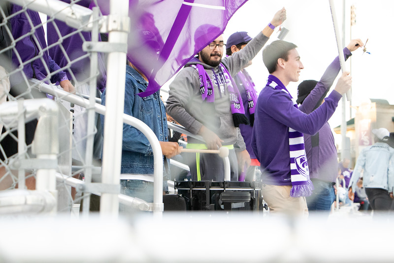 Shaking their keys and thumping on a drum Kansas State students get ready for the Oklahoma soccer game (Rowan Jones|Collegian Media Group)