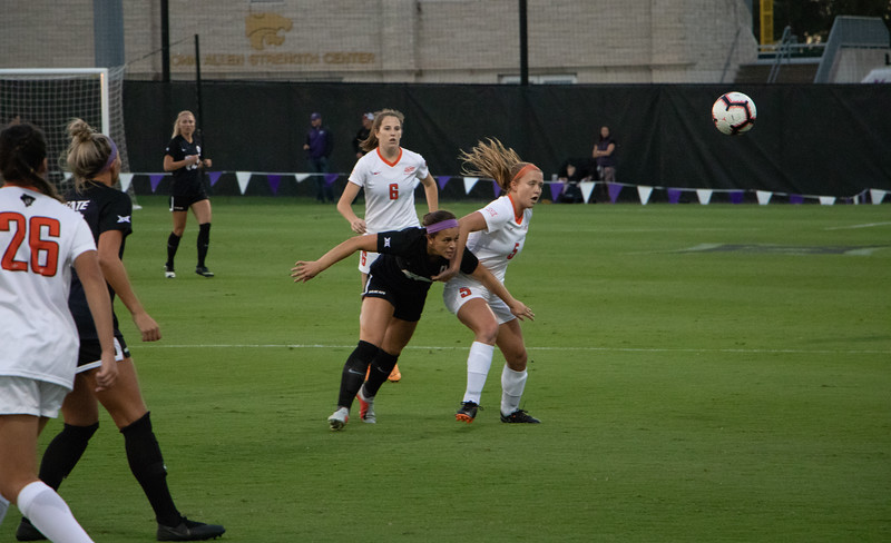 Midfielder Brookelyn Entz grapples with an Oklahoma State player for the ball. The sophmore had 2 shots on goal. (Rowan Jones|Collegian Media Group)r