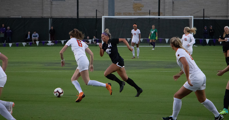 Sprinting for possesion of the ball Tatum Wagner, against Oklahoma State. The Wildcats lost the game 1-3 against the Cowboys despite a pressing offense in the first half of the game. r  (Rowan Jones|Collegian Media Group)