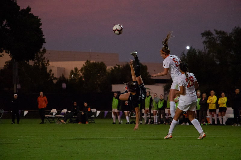 Throwing her legs up in the air Kansas State Mid-Fielder  Brookelyn Entz fights to redirect the ball away from the Wildcats goal. Unfortunately the ref called a high kicking offense for this stunt and possesion was given to the Cowboys (Rowan Jones|Collegian Media)
