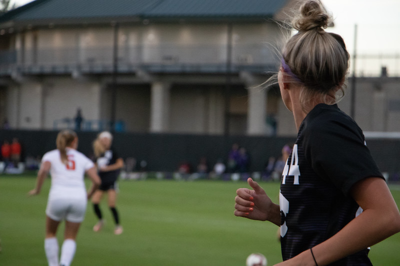 Looking back at the ball forward Tatum Wagner runs downfield. The senior has had 8 goals this season, and played for half of the game against Oklahoma State. (Rowan Jones Collegian Media Group)