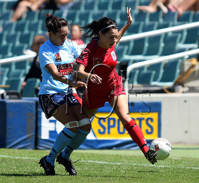 Donna Cockayne - Adelaide United is tackled by Sydney's Kiah Simon - Action from Westfield W-League Round 5 match between Sydney F.C and Adelaide United played at the Sydney Football Stadium on the 1st November 2009. The match was won by Sydney F.C 6-0 (PHOTO: ROB SHEELEY - SMP IMAGES) These images are intended for editorial use only (e.g. news or commentary print or electronic). Any commercial or promotional use requires additional clearance.