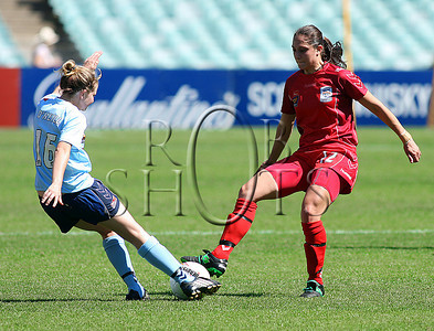 Sydney's Linda O'Neill (L) & Adelaide's Katerina Bexis battle for the ball - Action from Westfield W-League Round 5 match between Sydney F.C and Adelaide United played at the Sydney Football Stadium on the 1st November 2009. The match was won by Sydney F.C 6-0 (PHOTO: ROB SHEELEY - SMP IMAGES) These images are intended for editorial use only (e.g. news or commentary print or electronic). Any commercial or promotional use requires additional clearance.