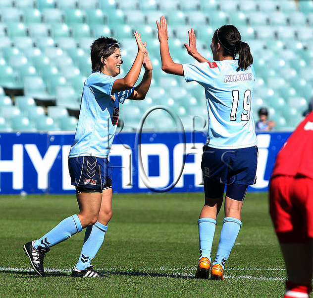 Catherine Cannulli - Sydney F.C is congratulated by team mate Leena Khamis after scoring a goal  - Action from Westfield W-League Round 5 match between Sydney F.C and Adelaide United played at the Sydney Football Stadium on the 1st November 2009. The match was won by Sydney F.C 6-0 (PHOTO: ROB SHEELEY - SMP IMAGES) These images are intended for editorial use only (e.g. news or commentary print or electronic). Any commercial or promotional use requires additional clearance.