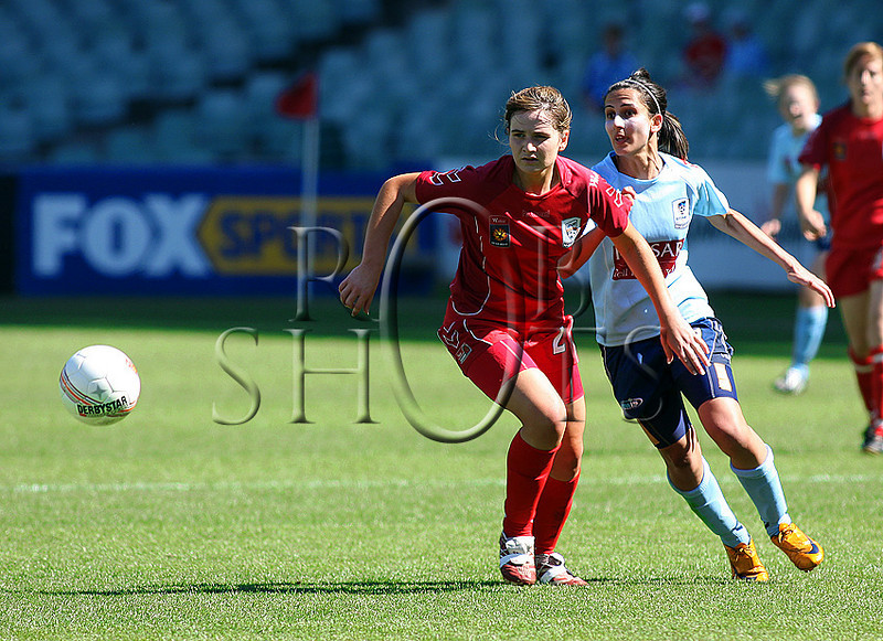 Ebony Weidenbach - Adelaide United chases a loose ball with Sydney's Leena Khamis - Action from Westfield W-League Round 5 match between Sydney F.C and Adelaide United played at the Sydney Football Stadium on the 1st November 2009. The match was won by Sydney F.C 6-0 (PHOTO: ROB SHEELEY - SMP IMAGES) These images are intended for editorial use only (e.g. news or commentary print or electronic). Any commercial or promotional use requires additional clearance.