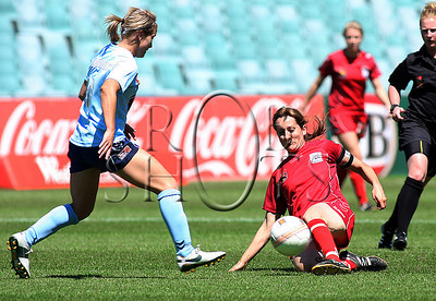 Christina Papageorgiou - Adelaide United slides in to gain possesion - Action from Westfield W-League Round 5 match between Sydney F.C and Adelaide United played at the Sydney Football Stadium on the 1st November 2009. The match was won by Sydney F.C 6-0 (PHOTO: ROB SHEELEY - SMP IMAGES) These images are intended for editorial use only (e.g. news or commentary print or electronic). Any commercial or promotional use requires additional clearance.