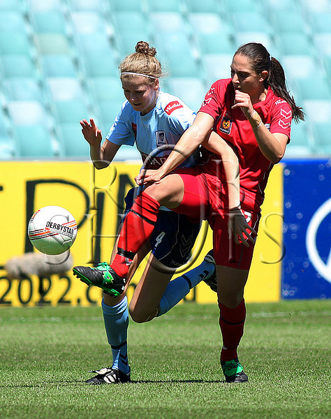 Alesha Clifford - Sydney F.C attempts to get around Adelaide's Katerina Bexis - Action from Westfield W-League Round 5 match between Sydney F.C and Adelaide United played at the Sydney Football Stadium on the 1st November 2009. The match was won by Sydney F.C 6-0 (PHOTO: ROB SHEELEY - SMP IMAGES) These images are intended for editorial use only (e.g. news or commentary print or electronic). Any commercial or promotional use requires additional clearance.