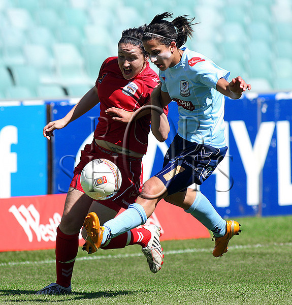 Adelaide's Renee Harrison and  Sydney's Leena Khamis battle for the ball - Action from Westfield W-League Round 5 match between Sydney F.C and Adelaide United played at the Sydney Football Stadium on the 1st November 2009. The match was won by Sydney F.C 6-0 (PHOTO: ROB SHEELEY - SMP IMAGES) These images are intended for editorial use only (e.g. news or commentary print or electronic). Any commercial or promotional use requires additional clearance.