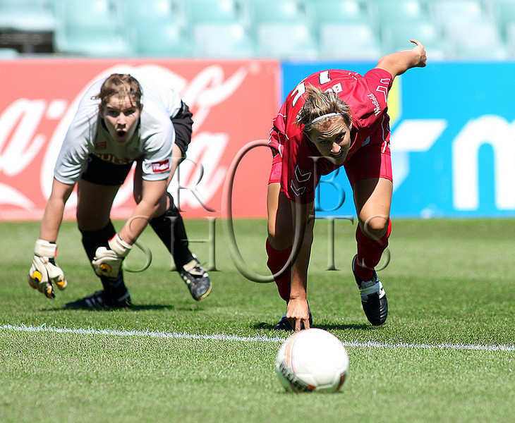 Tenneille Boaler - Adelaide United scrambles for a loose ball near the goal mouth - Action from Westfield W-League Round 5 match between Sydney F.C and Adelaide United played at the Sydney Football Stadium on the 1st November 2009. The match was won by Sydney F.C 6-0 (PHOTO: ROB SHEELEY - SMP IMAGES) These images are intended for editorial use only (e.g. news or commentary print or electronic). Any commercial or promotional use requires additional clearance.