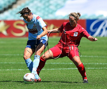 Julie Rydahl - Sydney F.C battles for the ball with Adelaide's Georgia Chapman - Action from Westfield W-League Round 5 match between Sydney F.C and Adelaide United played at the Sydney Football Stadium on the 1st November 2009. The match was won by Sydney F.C 6-0 (PHOTO: ROB SHEELEY - SMP IMAGES) These images are intended for editorial use only (e.g. news or commentary print or electronic). Any commercial or promotional use requires additional clearance.