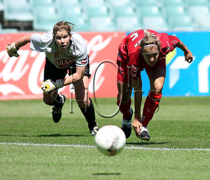 Tenneille Boaler - Adelaide United scrambles for a loose ball in the goal area - Action from Westfield W-League Round 5 match between Sydney F.C and Adelaide United played at the Sydney Football Stadium on the 1st November 2009. The match was won by Sydney F.C 6-0 (PHOTO: ROB SHEELEY - SMP IMAGES) These images are intended for editorial use only (e.g. news or commentary print or electronic). Any commercial or promotional use requires additional clearance.