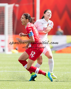 Christine Sinclair, Tan Ruyin