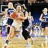 UML#3-Jaliena Sanchez breaks through Maine defence but was fouled trying for a shot. SUN/David H. Brow