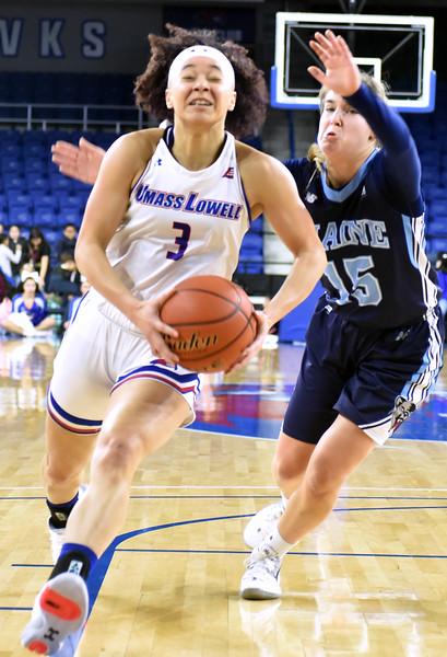 UML#3- Jaliena Sanchez heads for the hoop for a score as she drives past Me#-15-Dor Saar. SUN/David H. Brow