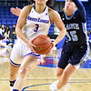 UML#3- Jaliena Sanchez heads for the hoop for a score as she drives past Me#-15-Dor Saar. SUN/David H. Brow