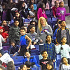 Teachers and students from the Moody School in Lowell dance to the music at the Womens basketball game as they played Maine. SUN/David H. Brow