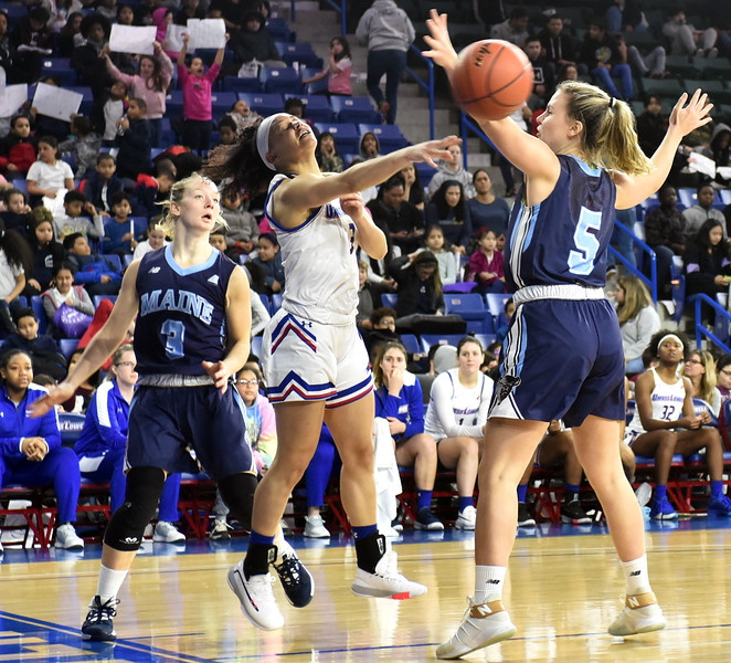UML #3-Jaliena Sanchez gets a pass off has Me#3-Anne Simon and Me #5-Maeve Carroll try to block. SUN/David H. Brow
