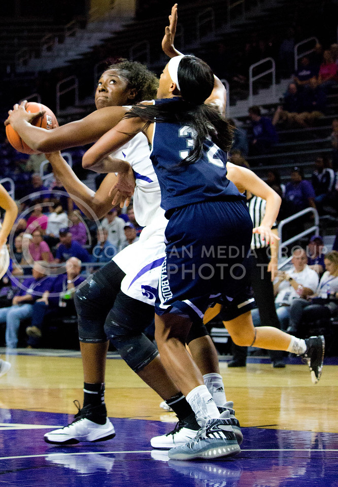 Breanna Lewis, senior center, defends the ball against a Washburn player during the K-State game against Washburn in Bramlage Coliseum on Nov. 4, 2016. (Alanud Alanazi   The Collegian)
