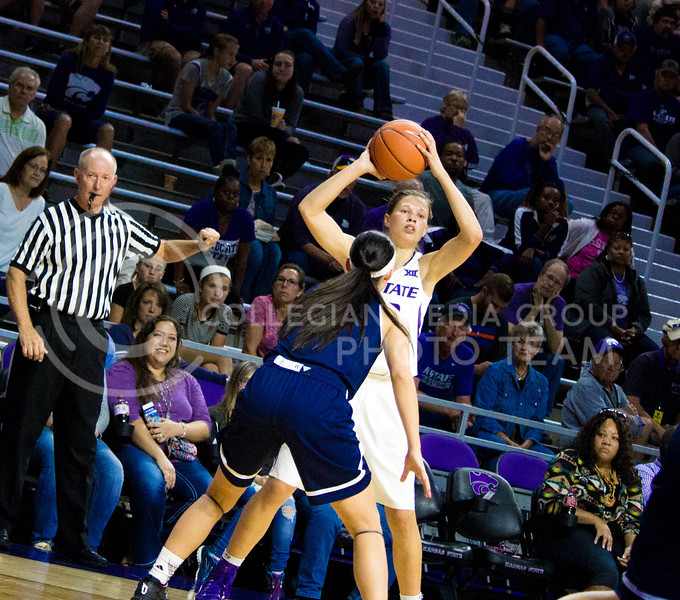 Kayla Goth, sophomore guard, tries to pass the ball to one of her teammates during the K-State game against Washburn in Bramlage Coliseum on Nov. 4, 2016. (Alanud Alanazi | The Collegian)