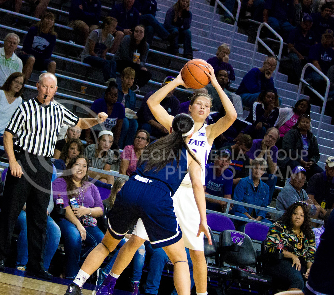 Kayla Goth, sophomore guard, tries to pass the ball to one of her teammates during the K-State game against Washburn in Bramlage Coliseum on Nov. 4, 2016. (Alanud Alanazi   The Collegian)