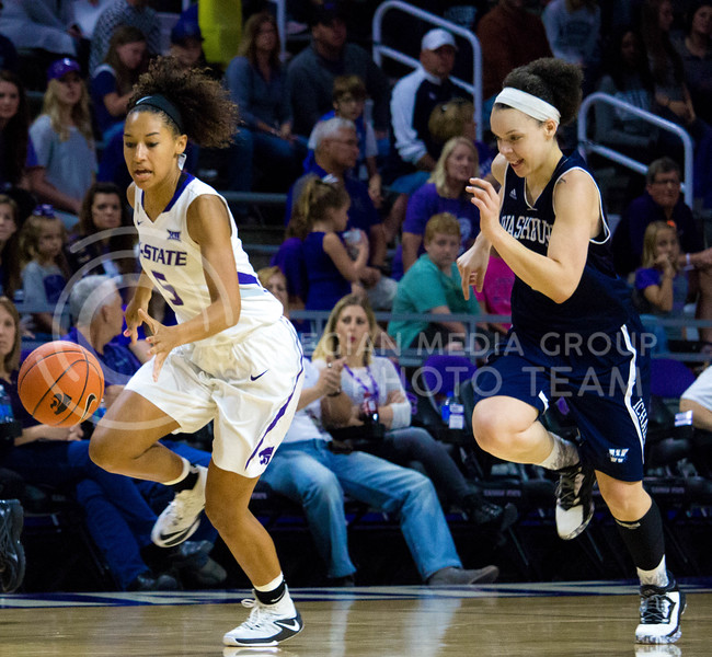 Mercedes Brooks, freshmen guard, runs to reach the ball during the K-State game against Washburn in Bramlage Coliseum on Nov. 4, 2016. (Alanud Alanazi | The Collegian)