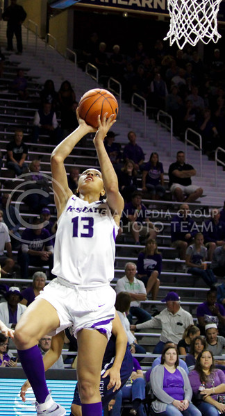 Eternati Willock, freshmen forward, jumps to throw the ball in the basket during the K-State game against Washburn in Bramlage Coliseum on Nov. 4, 2016. (Alanud Alanazi | The Collegian)