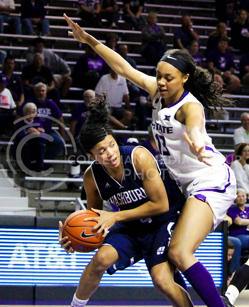Eternati Willock, freshmen forward, blocks a Washburn player during the K-State game against Washburn in Bramlage Coliseum on Nov. 4, 2016. (Alanud Alanazi | The Collegian)