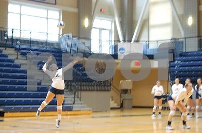 Junior Lauren Schmitz mid serve