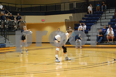 Sophmore Katie Truluck serving the ball.