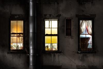three windows on a cold night