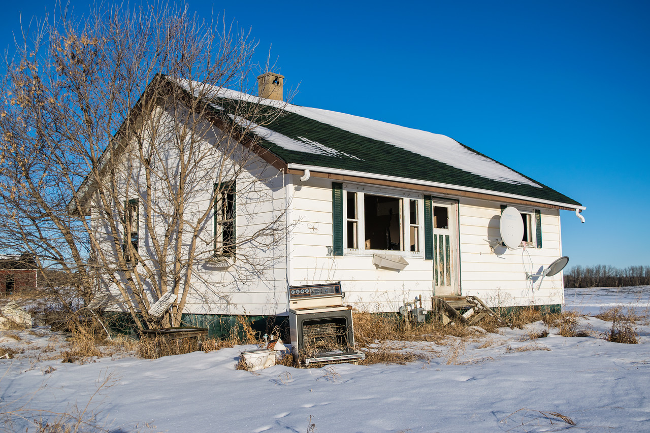 There was nothing really special about this home. It was highly vandalized and pretty much empty. However, the older outbuildings had a few pleasant surprises!