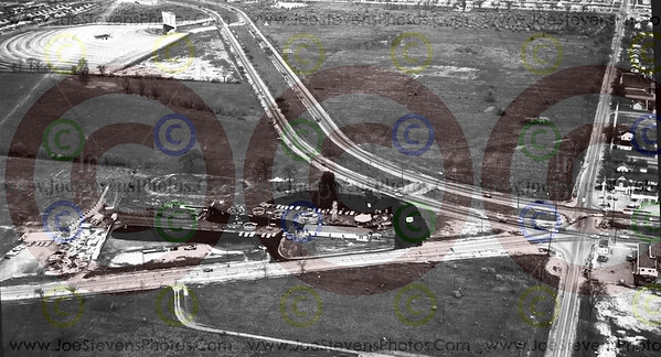 A great photo of Wonderland Park 1959/60 with a great view of the old Fort George Drive-In up in the left.  Those were the days.  I saw Urban Cowboy at that Drive Inn when it 1st came out.  Pile up the kids, lots of treats, blankets & pillows & you were in for a cozy night.  There is a Meijer's there now & across from that is all built up.  These photo's are actually art history.  Art being the format of Photography & the history of what this area will never again look like.  Ths is where they have the Downriver Cruise every summer, right along Fort. St.  Fort, in this photo, goes up & curves.  To the right where there is an open field, is where a Big Kmart store is now & a popular place for the classic cars to park for the Cruise.