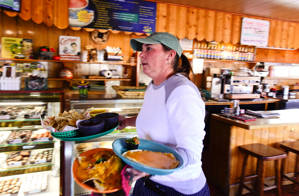 . GOLDEN, CO - JANUARY 20:Server/Bartender Sue Widholm brings food to customers at the Wondervu Cafe in Coal Creek Canyon on Jan. 20, 2019.  (Photo by Matthew Jonas/Staff Photographer)