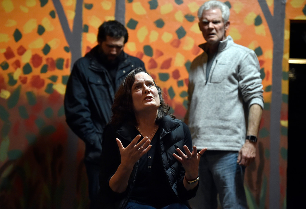 ". BOULDER, CO - JANUARY 07, 2019: Madge Montgomery, front, Michael Gurshtein and Brad Rutledge perform a scene during a rehearsal for the play ""Wood Smoke\"" on Monday night at the Mary Miller Theater in Lafayette. For more photos of the rehearsal go to dailycamera.com (Photo by Jeremy Papasso/Staff Photographer)"