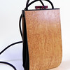 """Alcea"" wooden purse by Mark Diebolt. The purse measures 4.25"" wide x 7.5"" tall x 2"" deep. Made from birdseye maple, black obechi, hybrid acrylic and leather. $210 (price subject to change without notice). Call 800.272.3870 to order."