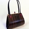 """Emilia"" wooden purse by Mark Diebolt. The purse measures 8.25"" wide x 6"" tall x 3"" deep. Made from macassar ebony, curly maple, hybrid acrylic and leather. $345 (price subject to change without notice). Call 800.272.3870 to order."