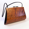 """Aristea"" wooden purse by Mark Diebolt. The purse measures 11.5"" wide x 7"" tall x 3.75"" deep. Made from quilted sapele, curly maple, hybrid acrylic and leather. $370 (price subject to change without notice). Call 800.272.3870 to order."