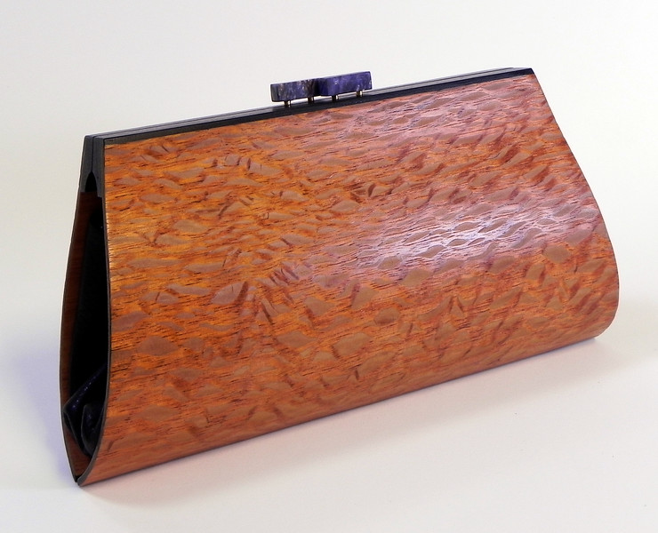 """Zea"" wooden purse by Mark Diebolt. The purse measures 9"" wide x 4.75"" tall x 2.25"" deep. Made from lacewood, black obechi, hybrid acrylic and leather and hidden magnetic clasp. $260 (price subject to change without notice). Call 800.272.3870 to order."