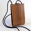 """Alcea"" wooden purse by Mark Diebolt. The purse measures 4.25"" wide x 7.5"" tall x 2"" deep. Made from zebrawood, black obechi, hybrid acrylic and leather. $210 (price subject to change without notice). Call 800.272.3870 to order."