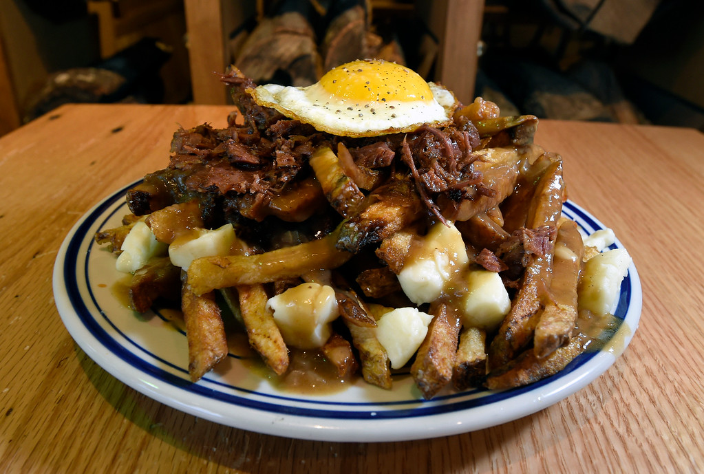 . The Poutine with fries, pastrami, curds, gravy and an egg at WoodGrain Bagels on Thursday in Boulder. For more photos of the restaurant go to www.dailycamera.com Jeremy Papasso/ Staff Photographer/ May 25, 2017
